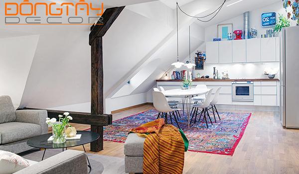 Phòng khách và phòng ăn được thiết kế liền kề tạo cảm giác thông thoáng.